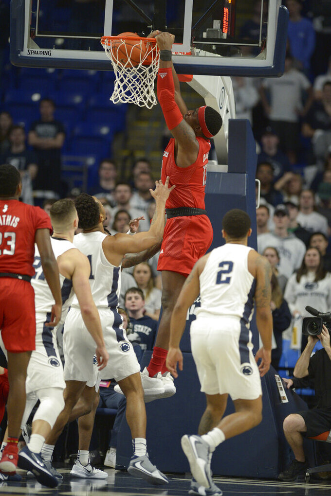 Rutgers Shaq Carter (13) dunks against Penn State during the first half of an NCAA college basketball game, Wednesday, Feb. 26, 2020, in State College, Pa. (AP Photo/Gary M. Baranec)