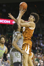 Texas forward Jericho Sims, right, shoots over Baylor guard Mark Vital, left, in the first half of an NCAA college basketball game, Saturday, Jan. 4, 2020, in Waco, Texas. (AP Photo/Rod Aydelotte)