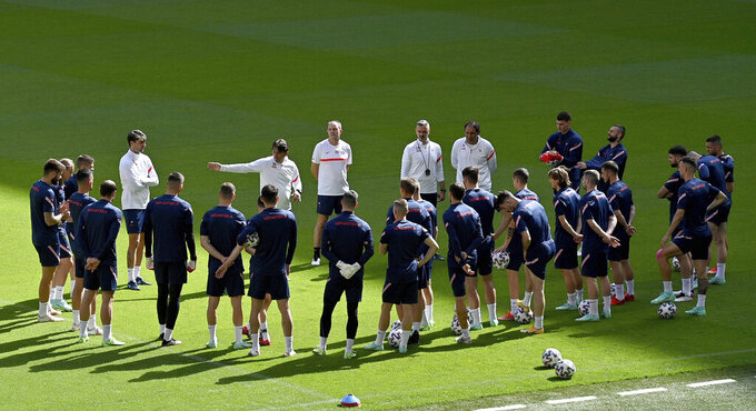 Croatia players listen to Croatia's manager Zlatko Dalic, centre, during a team training session at Wembley stadium in London, Saturday, June 12, 2021 the day before the Euro 2020 soccer championship group D match between England and Croatia. (Justin Tallis/Pool via AP)