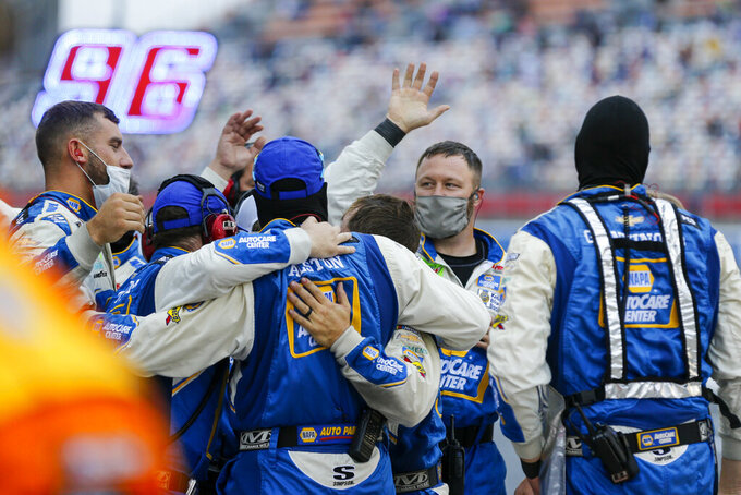 Chase Elliott's pit crew celebrate on pit road after Elliot won a NASCAR Cup Series auto race at Charlotte Motor Speedway in Concord, N.C., Sunday, Oct. 11, 2020. (AP Photo/Nell Redmond)