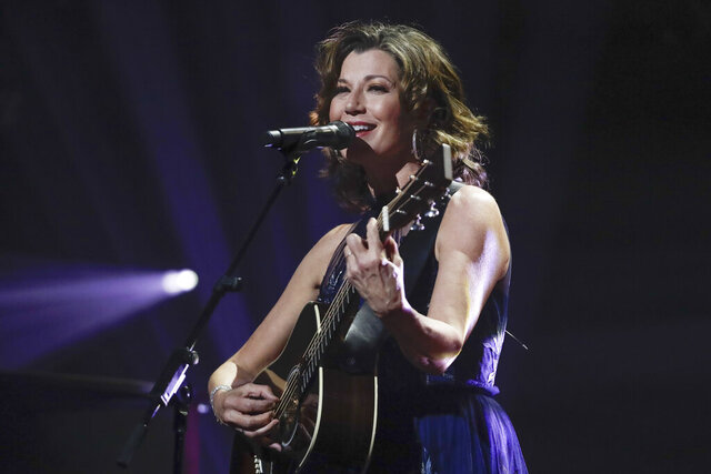"FILE - In this Oct. 15, 2019 file photo, singer Amy Grant performs during the Dove Awards in Nashville, Tenn. Grant has had open heart surgery to fix a heart condition she has had since birth. A publicist for the singer said doctors discovered the condition during a routine checkup. Grant is married to country singer Vince Gill and is a six-time Grammy winner with hits like ""Baby, Baby,"" and ""That's What Love is For."