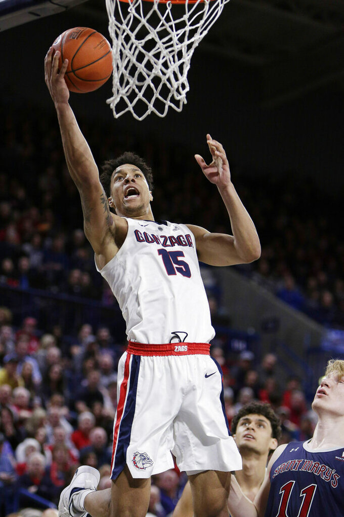 Gonzaga forward Brandon Clarke (15) shoots in front of Saint Mary's forward Matthias Tass (11) during the second half of an NCAA college basketball game in Spokane, Wash., Saturday, Feb. 9, 2019. Gonzaga won 94-46. (AP Photo/Young Kwak)