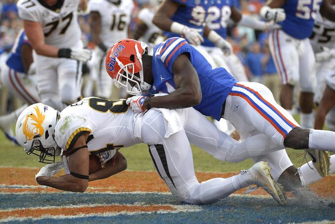 Missouri wide receiver Emanuel Hall (84) catches a pass in the end zone in front of Florida defensive back Trey Dean III (21) for a 4-yard touchdown during the second half of an NCAA college football game Saturday, Nov. 3, 2018, in Gainesville, Fla. (AP Photo/Phelan M. Ebenhack)