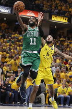 FILE - In this April 19, 2019, file photo, Boston Celtics' Kyrie Irving (11) shoots against Indiana Pacers' Cory Joseph (6) during the second half of Game 3 of an NBA basketball first-round playoff series in Indianapolis. Rarely relevant at the same time on the basketball court, the Knicks and Nets are front and center in the free agency race, two of the teams best positioned to make a splash when the market opens. Both can afford two top players, with hopes of landing not only a Kevin Durant or Kyrie Irving, but possibly even both. (AP Photo/Darron Cummings, File)