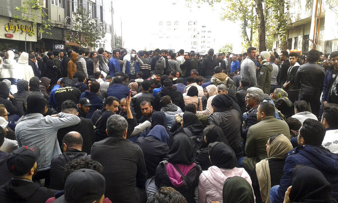 Protestors attend a demonstration after authorities raised gasoline prices, in the northern city of Sari, Iran, Saturday, Nov. 16, 2019. Protesters angered by Iran raising government-set gasoline prices by 50% blocked traffic in major cities and occasionally clashed with police Saturday after a night of demonstrations punctuated by gunfire. (Mostafa Shanechi/ ISNA via AP)