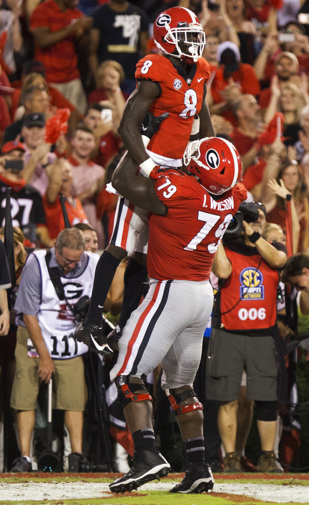 Georgia wide receiver Riley Ridley (8) and offensive guard Thomas Swilley (75) celebrate after Ridley's touchdown against Vanderbilt during the first half of an NCAA college football game Saturday, Oct. 6, 2018, in Athens, Ga. (Jenn Finch/Athens Banner-Herald via AP)