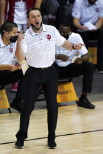 Indiana head coach Archie Miller directs his team in the first half of a semifinal NCAA college basketball game in the Maui Invitational tournament against Texas, Tuesday, Dec.1, 2020, in Asheville, N.C. (AP Photo/Kathy Kmonicek)
