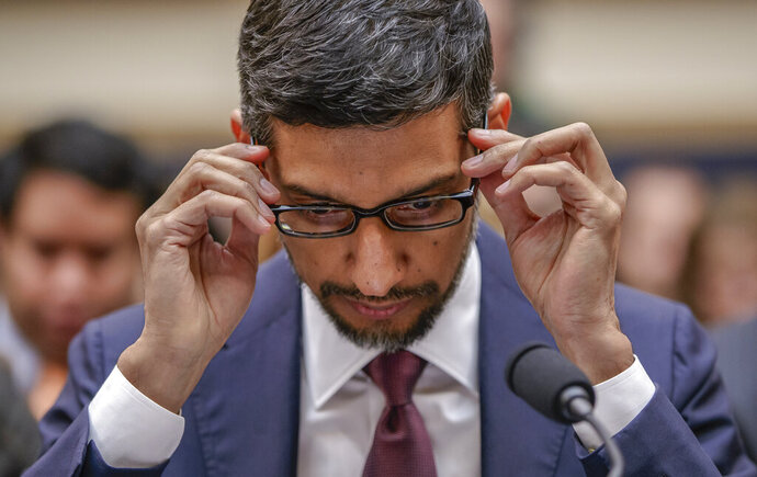 FILE - In this Dec. 11, 2018, file photo Google CEO Sundar Pichai appears before the House Judiciary Committee to be questioned about the company's privacy security and data collection, on Capitol Hill in Washington. Google co-founders Larry Page and Sergey Brin are stepping down from their roles within the parent company, Alphabet. Pichai will stay in his role and also become CEO of Alphabet. (AP Photo/J. Scott Applewhite, File)