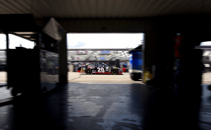 Erik Jones drives though the garage area during a practice session for Sunday's NASCAR Cup Series auto race, Saturday, July 27, 2019, in Long Pond, Pa. (AP Photo/Derik Hamilton)