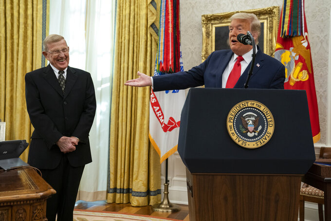 President Donald Trump speaks during a ceremony to present the Presidential Medal of Freedom to former football coach Lou Holtz, in the Oval Office of the White House, Thursday, Dec. 3, 2020, in Washington. (AP Photo/Evan Vucci)