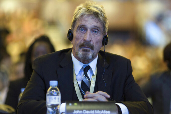 FILE - In this Tuesday, Aug. 16, 2016 file photo, founder of the first commercial anti-virus program that bore his name, John McAfee listens during the 4th China Internet Security Conference (ISC) in Beijing.  Detained antivirus software entrepreneur John McAfee has testified in a Spanish court as part of his fight against extradition to the United States. He is wanted by Tenessee on tax-related criminal charges that carry prison sentences of up to 30 years. McAfee, 75, appeared from prison via videolink at a hearing Tuesday, June 15, 2021 in Spain's National Court. (AP Photo/Ng Han Guan, File)