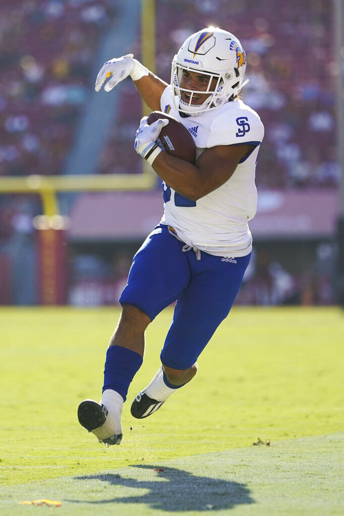 San Jose State running back Kairee Robinson (32) runs the ball during the second half of an NCAA college football game against Southern California Saturday, Sept. 4, 2021, in Los Angeles. (AP Photo/Ashley Landis)
