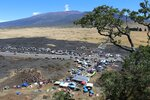 FILE - In this Sunday, July 21, 2019, file photo provided by the Hawaii Department of Land and Natural Resources, protesters block a road to the summit of Mauna Kea where scientists want to build a telescope in Hawaii. To avoid the appearance of a conflict of interest, the Hawaii attorney general's office will take over prosecution of protesters arrested for blocking construction of a giant telescope. Big Island prosecutor Mitch Roth said Wednesday, Sept. 18, 2019, he turned over the cases in response to an Associated Press story highlighting concerns that his son's employment with a telescope partner is a possible conflict. (Dan Dennison/Hawaii Department of Land and Natural Resources via AP, File)