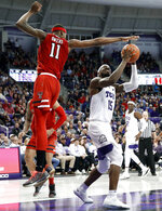 Texas Tech forward Tariq Owens (11) goes up to block a shot attempt by TCU forward JD Miller (15) in the second half of an NCAA college basketball game in Fort Worth, Texas, Saturday, March 2, 2019. (AP Photo/Tony Gutierrez)