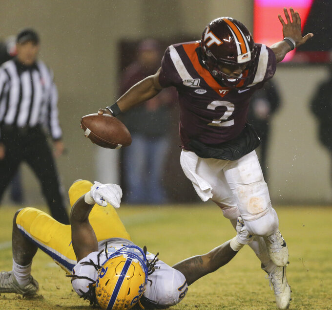 Virginia Tech quarterback Hendon Hooker (2) attempts to elude Pittsburgh defender Patrick Jones II (91) in the forth quarter of an NCAA college football game in Blacksburg Va. Saturday, Nov. 23 2019. (Matt Gentry/The Roanoke Times via AP)
