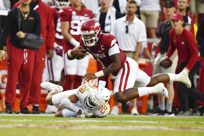 Arkansas quarterback KJ Jefferson (1) is tripped by Texas defender Jerrin Thompson (28) after a long gain during the first half of an NCAA college football game Saturday, Sept. 11, 2021, in Fayetteville, Ark. (AP Photo/Michael Woods)
