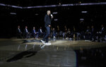 Former San Antonio Spurs guard Tony Parker speaks during his retirement ceremony after the team's NBA basketball game against the Memphis Grizzlies in San Antonio, Monday, Nov. 11, 2019. (AP Photo/Eric Gay)