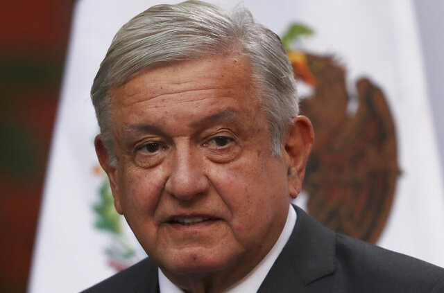 FILE - In this Dec. 1, 2020 file photo, Mexican President Andres Manuel Lopez Obrador speaks during the commemoration of his second anniversary in office, at the National Palace in Mexico City. The lower house of Mexico's congress overwhelmingly approved a controversial law Tuesday, Dec. 15, 2020, limiting foreign agents and lifting their immunity. The vote sends the bill to President Lopez Obrador for his signature. (AP Photo/Marco Ugarte, File)
