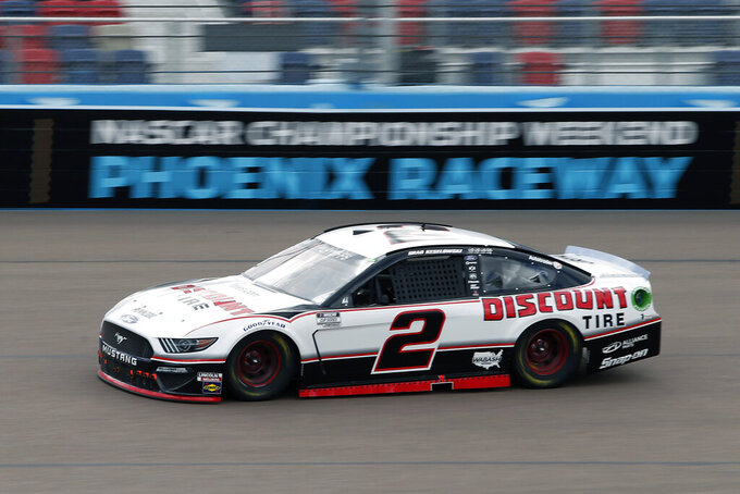 Brad Keselowski (2) races through Turn 4 during the NASCAR Cup Series auto race at Phoenix Raceway, Sunday, Nov. 8, 2020, in Avondale, Ariz. (AP Photo/Ralph Freso)