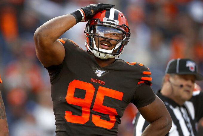Cleveland Browns defensive end Myles Garrett (95) reacts to missed defensive stop against the Denver Broncos during the first half of NFL football game, Sunday, Nov. 3, 2019, in Denver. (AP Photo/David Zalubowski)