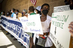 Carroll Independent School District parents protest for a mask mandate before the school board meeting Monday, Aug. 23, 2021, outside of the school administration building in Southlake, Texas. (Yffy Yossifor/Star-Telegram via AP)