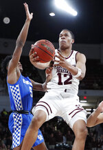 Mississippi State guard Robert Woodard (12) attempts a layup past Kentucky guard Immanuel Quickley (5) during the first half of an NCAA basketball game in Starkville, Miss., Saturday, Feb. 9, 2019. (AP Photo/Rogelio V. Solis)