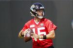 =Jacksonville Jaguars quarterback Gardner Minshew looks for a receiver during NFL football practice, Friday, Aug. 6, 2021, in Jacksonville, Fla. (AP Photo/John Raoux)