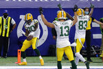 Green Bay Packers' Jamaal Williams (30) celebrates a touchdown during the first half of an NFL football game against the Indianapolis Colts, Sunday, Nov. 22, 2020, in Indianapolis. (AP Photo/AJ Mast)