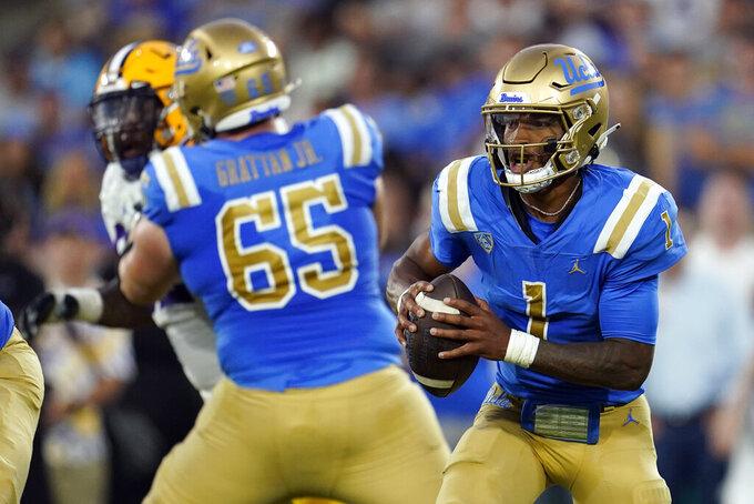 UCLA quarterback Dorian Thompson-Robinson (1) scrambles during the first half of the team's NCAA college football game against LSU on Saturday, Sept. 4, 2021, in Pasadena, Calif. (AP Photo/Marcio Jose Sanchez)