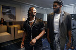 Los Angeles Rams running back Todd Gurley, left, and Minnesota Timberwolves center Karl-Anthony Towns walks together during the High School Athlete of the Year Awards Tuesday, July 9, 2019, in Los Angeles. (AP Photo/Marcio Jose Sanchez)