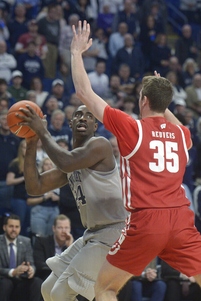 Penn State's Mike Watkins (24) looks to shoot on Wisconsin's Nate Reuvers (35) during first half action of an NCAA college basketball game, Saturday, Jan. 11, 2020, in State College, Pa. (AP Photo/Gary M. Baranec)