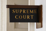 The sign for the Pennsylvania Supreme Court is posted by its door at City Hall in Philadelphia, Wednesday, Sept. 11, 2019. The Pennsylvania Supreme Court is set to consider whether the death penalty amounts to cruel, arbitrary punishment that's too often reserved for black and poor defendants. (AP Photo/Matt Rourke)