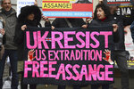 Supporters of Wikileaks founder Julian Assange demonstrate oustide Westminster Magistrates' Court in London where Assange is expected to appear as he fights extradition to the United States on charges of conspiring to hack into a Pentagon computer, in London, Monday, Oct, 21, 2019. U.S. authorities accuse Assange of scheming with former Army intelligence analyst Chelsea Manning to break a password for a classified government computer. (Kirsty O'Connor/PA via AP)