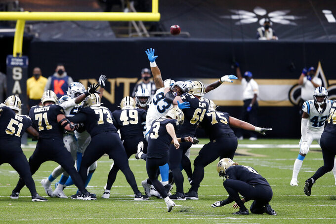 New Orleans Saints kicker Wil Lutz (3) kicks a field goal in the second half of an NFL football game against the Carolina Panthers in New Orleans, Sunday, Oct. 25, 2020. (AP Photo/Butch Dill)