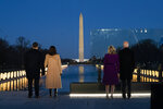 President-elect Joe Biden and his wife Jill Biden are joined by Vice President-elect Kamala Harris and her husband Doug Emhoff during a COVID-19 memorial event at the Lincoln Memorial Reflecting Pool, Tuesday, Jan. 19, 2021, in Washington. (AP Photo/Evan Vucci)
