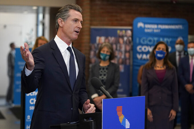 FILE — In this July 26, 2021 file photo Gov. Gavin Newsom speaks at a news conference in Oakland, Calif. Conservative radio talk show host Larry Elder has emerged as the top contender for those who are looking to unseat Newsom in the Sept. 14th recall election. Elder, who is running to replace Newsom in the Sept. 14 recall election, says he would erase state vaccine and mask mandates, is critical of gun control, opposes the minimum wage and disputes the notion of systemic racism in America. (AP Photo/Jeff Chiu, File)