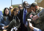 Attorney Ben Crump, center, and relatives of Anthony Jose Vega Cruz gather in Wethersfield, Conn., on Wednesday, May 8, 2019, to decry the killing of Vega Cruz by a Wethersfield police officer. Officer Layau Eulizier fatally shot Vega Cruz on April 20 as Vega Cruz drove toward the officer while fleeing a traffic stop. Eulizier's lawyer said the shooting was justified. (AP Photo/Dave Collins)
