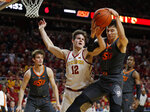 Iowa State forward Michael Jacobson, center, and Oklahoma State guard Lindy Waters, right, battle for a rebound during the first half of an NCAA college basketball game, Saturday, Jan. 19, 2019, in Ames. (AP Photo/Matthew Putney)