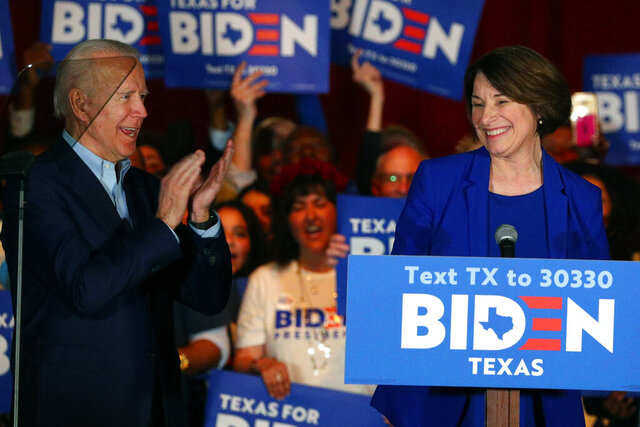 FILE - In this March 2, 2020 file photo, Sen. Amy Klobuchar, D-Minn., endorses Democratic presidential candidate former Vice President Joe Biden at a campaign rally Monday, March 2, 2020 in Dallas. As presumptive Democratic presidential nominee Joe Biden begins the process of choosing a running mate amid the coronavirus crisis, managing the pandemic has become its own version of an audition. For potential picks, lobbying for the job means breaking into the national conversation, positioning themselves as leaders and executing at their day job. (AP Photo/Richard W. Rodriguez)