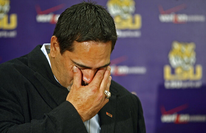 FILE - In this Sept. 10, 2010, file photo, former Tennesee Titans' Kevin Mawae wipes away tears during a press conference after announcing his retirement, in Nashville, Tenn. Mawae will be inducted into the Pro Football Hall of Fame in Canton, Ohio on Aug. 3, 2019. (Jae S. Lee/The Tennessean via AP, File)