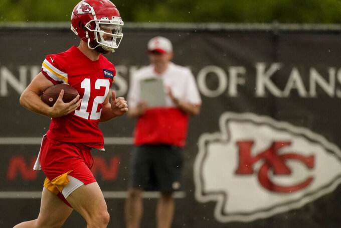 Kansas City Chiefs wide receiver Gehrig Dieter runs the ball during the NFL football team's organized team activities Thursday, May 27, 2021, in Kansas City, Mo. (AP Photo/Charlie Riedel)
