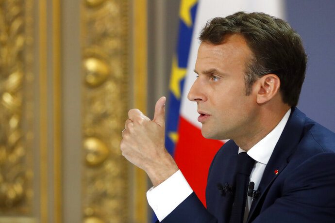 French President Emmanuel Macron delivers a speech at the Elysee Palace Thursday, April 25, 2019 in Paris. Macron makes a speech at the Elysee presidential palace based on three months of national debate aimed at addressing the protesters' concerns through town hall meetings and collecting complaints online. (AP Photo/Michel Euler)
