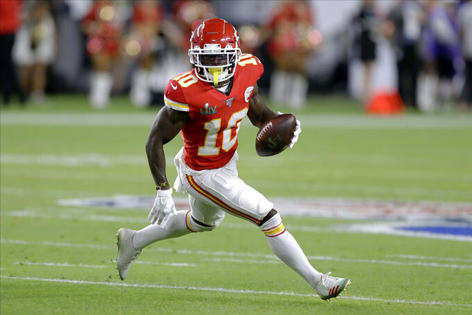 Kansas City Chiefs' Tyreek Hill runs against the San Francisco 49ers during the first half of the NFL Super Bowl 54 football game Sunday, Feb. 2, 2020, in Miami Gardens, Fla. (AP Photo/Chris O'Meara)
