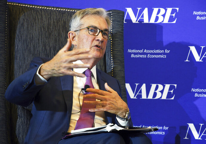 Federal Reserve Chairman Jerome Powell speaks at the National Association for Business Economics conference in Denver on Tuesday, Oct. 8, 2019. Powell said that U.S. job growth since early last year was not as robust as thought, a hint that the Fed may be ready to keep cutting interest rates to support the economy. Downward revisions to the government's hiring data, announced in August, suggest less upward pressure on wages and inflation. (AP Photo/Thomas Peipert)