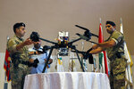 Lebanese Army soldiers show journalists an Israeli drone that crashed in southern Beirut last month during a press conference to announce the results of an investigation into the incident, at the Lebanese Defense Ministry, in Yarzeh near Beirut, Lebanon, Thursday, Sept. 19, 2019. The investigation has concluded that two Israeli drones that crashed in the Lebanese capital last month were on an attack mission, one of them armed with 4.5 kilograms of explosives. (AP Photo/Bilal Hussein)