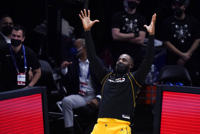 Los Angeles Lakers forward LeBron James celebrates during the first half of basketball's NBA All-Star Game in Atlanta, Sunday, March 7, 2021. (AP Photo/Brynn Anderson)