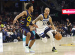 Minnesota Timberwolves' Shabazz Napier (13) drives to the basket against Cleveland Cavaliers' Darius Garland (10) in the second half of an NBA basketball game, Sunday, Jan. 5, 2020, in Cleveland. Minnesota won 118-103. (AP Photo/Tony Dejak)