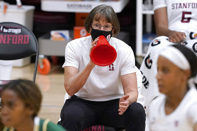 Stanford head coach Tara VanDerveer, center, uses a megaphone to yell out a play to her team during the first half against Cal Poly in an NCAA college basketball game in Stanford, Calif., Wednesday, Nov. 25, 2020. (AP Photo/Tony Avelar)