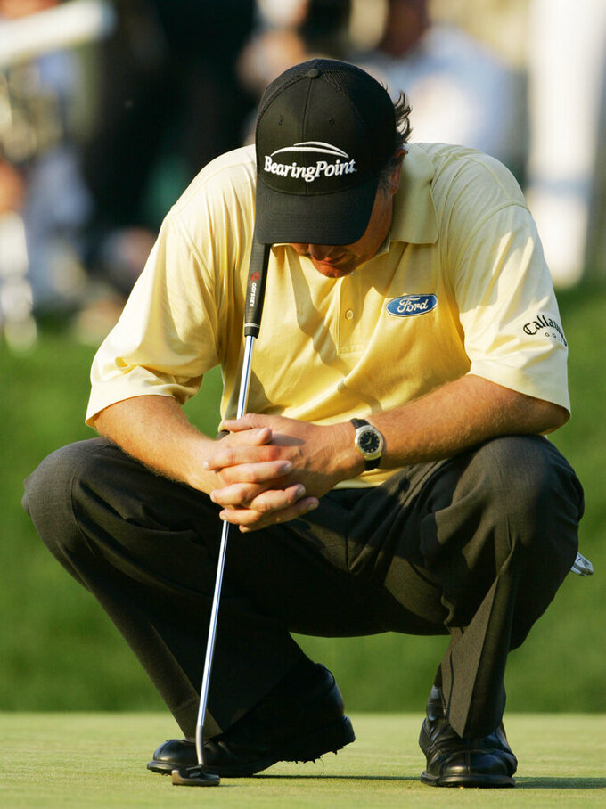 FILE - In this June 18, 2006, file photo, Phil Mickelson, of the United States, waits to putt on the 18th green in the final round of the U.S. Open at Winged Foot Golf Club in Mamaroneck, N.Y. Mickelson lost to Geoff Ogilvy of Australia. Mickelson is now exempt to return to Winged Foot for the U.S. Open in September. (AP Photo/Charles Krupa, File)