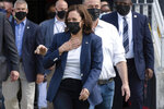 Vice President Kamala Harris walks on to the field with her husband Doug Emhoff before an NCAA college football game between Howard and Hampton at Audi Field in Washington, Saturday, Sept. 18, 2021. Harris attended Howard University and graduated in 1986. (AP Photo/Cliff Owen)